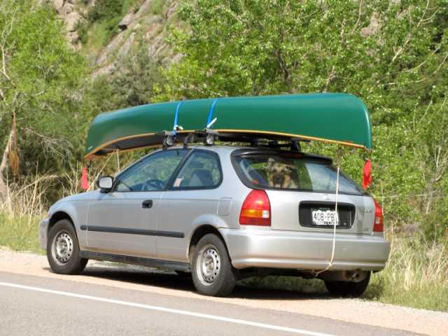 My little car doing a big job: hauling Cora and a canoe.