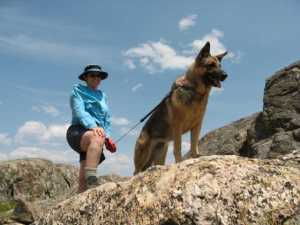 Adventure Dog on the rocks overlooking Emmaline Lake