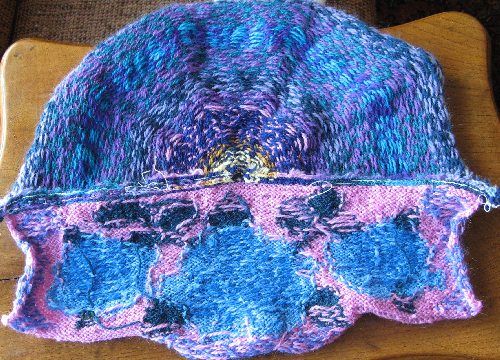 The wrong side of the back/flap, showing the different knitting techniques used