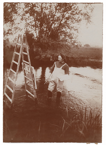 Painter Louis Aston Knight working on his creative ladder... literally!
