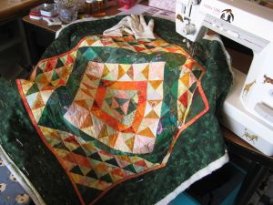 My Green-Yellow-Orange quilt in the process of being quilted.