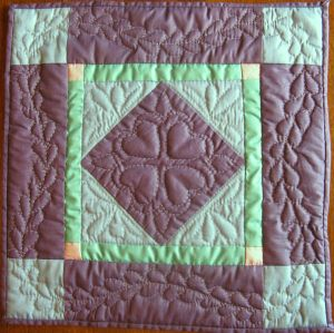 My hand-quilting test. This little quilt is only a foot square. Quilt by Kit Dunsmore
