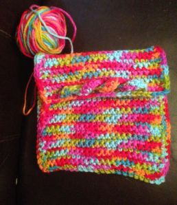 Kristen Lamb's Kindle cover. I love the candy-colored yarn and the curly doodad on the flap.