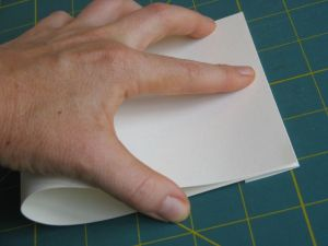 Folding the page in half (the tab is underneath)