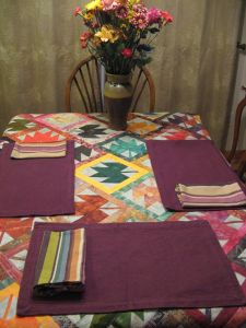 The table cloth is an unfinished quilt top. I love how it looks!