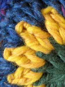 If you look closely, you can see that the yellow is really one strand of yellow and one of gold.