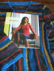 The book Yarnplay has the sweater I'm making right on the cover. Also in this picture is the first version of the sweater knit in 2008.