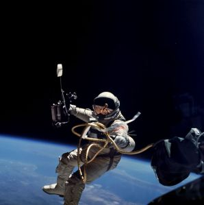 Ed White takes the first U.S. space walk. (Astronauts train for low gravity in swimming pools.)