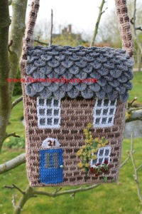 The Twisted Yarn's crocheted house bag.