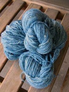 My handspun: nearly 100 grams (3.4 ounces) of naturally dyed Corriedale (indigo) and silk (marigold).