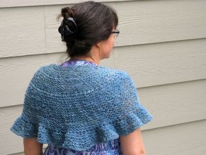 The finished shawl. I've already worn it to the grocery store to fend off the air conditioning, and it worked great.