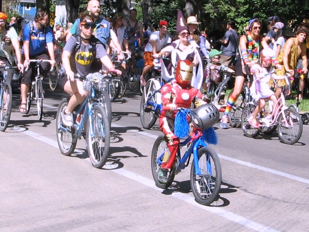 You don't have to be big to be super. An amazing ironman, with batman right behind him.