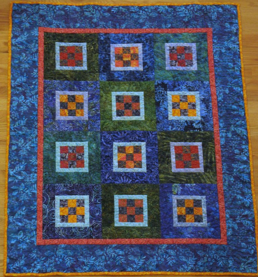 Square Dance, pieced and machine-quilted by Kit Dunsmore