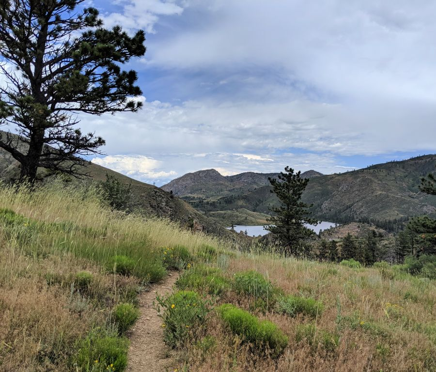 Black Powder trail, foothills with lake; photo by Kit Dunsmore
