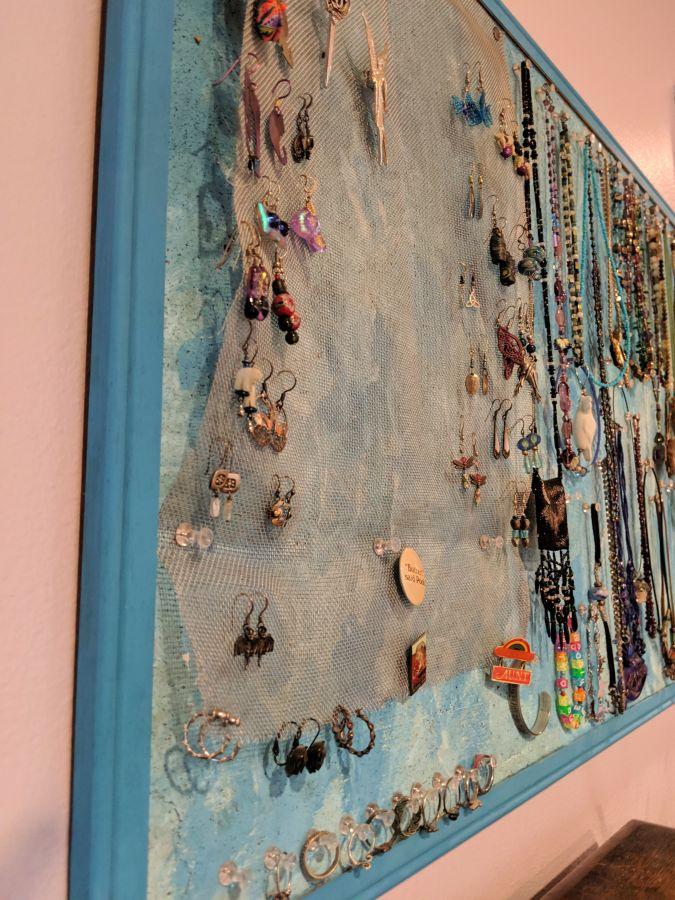 Close up of earring hanger on DIY jewelry storage board. Photo and board by Kit Dunsmore