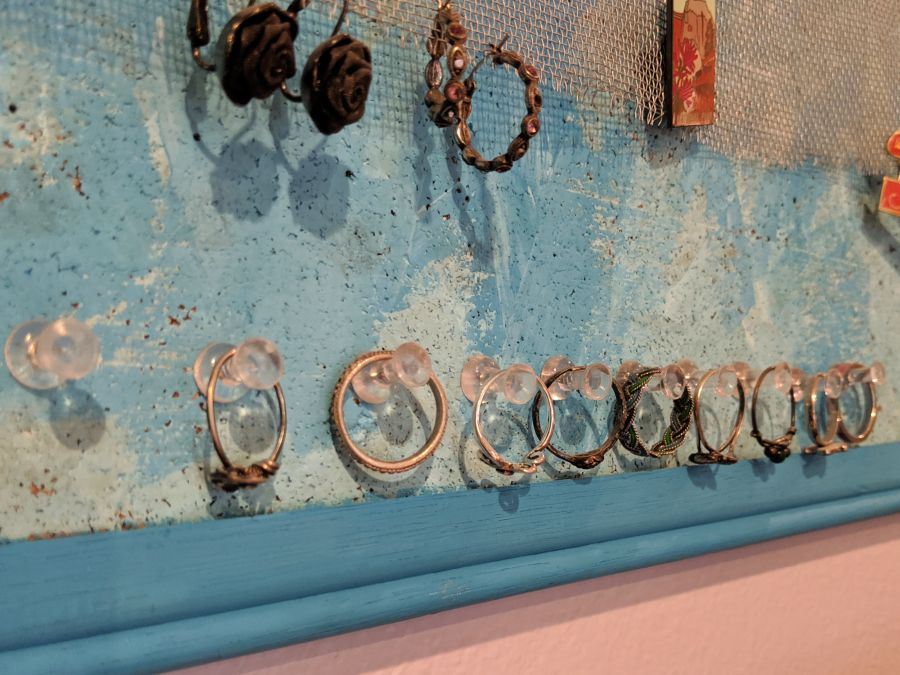 Close up of rings stored on DIY jewelry board. Photo and board by Kit Dunsmore.