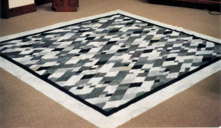 Sigh No More quilt top by Kit Dunsmore; Black and gray diamond pattern